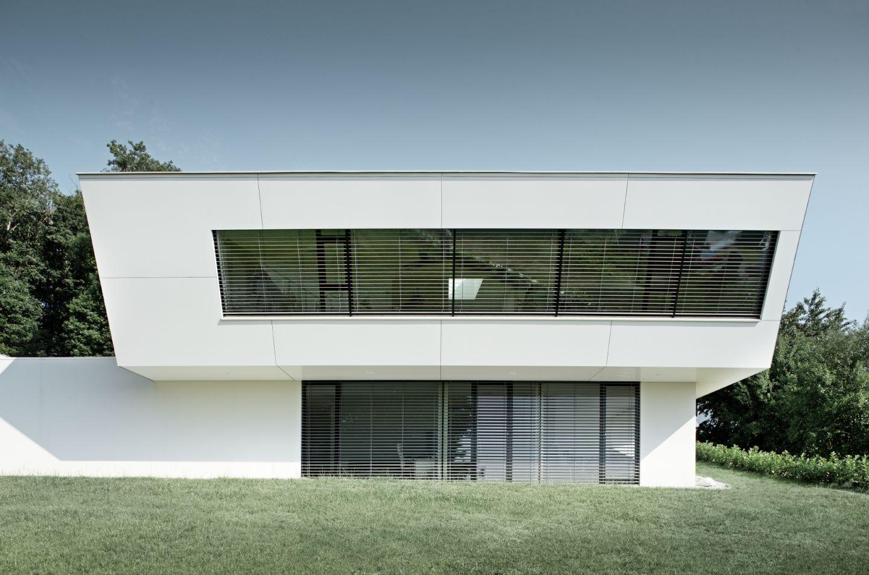 Ein einfamilienhaus im futuristischen design for Design einfamilienhaus